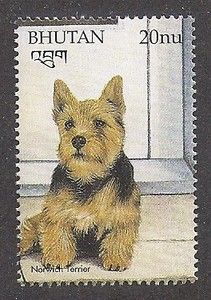 Bhutan postage stamp featuring the Norwich Terrier