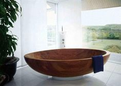 A wood tub in the bathroom.