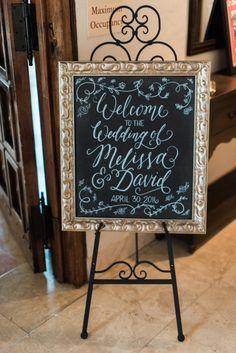 Gold framed chalkboard welcome sign: http://www.stylemepretty.com/2016/09/02/classichouston-wedding-with-pop-of-red/ Photography: Dana Fernandez - http://www.danafernandezphotography.com/