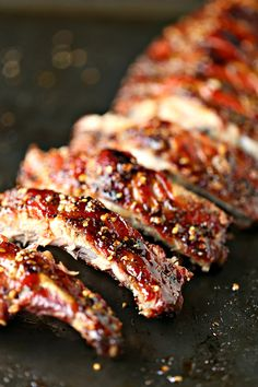 Easy Grilled Honey-Garlic Ribs from kissmysmoke.com- This is a simple, no-fuss recipe for honey garlic ribs that will make your taste buds do the happy dance. You can easily customize this to your own taste and heat preferences. Make this recipe today!