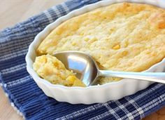 Corn Pudding -- I can creamed corn, I can whole corn, 1/4 cup melted butter, 1 box corn muffin mix, 1 cup sour cream, 3 eggs. Bake 35-40 min at 375.