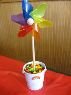Great Idea for a rainbow party and for displaying pinwheels. Colorful candy bucket idea too! Check out this shop, Pinwheel Pretties, for tons of pretty pinwheels! Rainbow Dash Party, Rainbow Birthday Party, 6th Birthday Parties, Birthday Fun, Birthday Ideas, Park Birthday, My Little Pony Party, Rainbow Centerpiece, Centerpiece Ideas