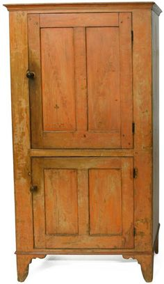 Early 19th century grain-painted cupboard, the cove molded rectangular top above two paneled doors and molded base, all resting on shaped bracket feet, 64 H. x 34.63 W. x 17 D.