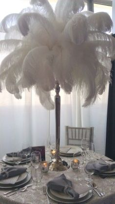 don't care for the feathers but like the tall silver stand and the pearls on the napkins. There are also pearls on the chair covers Feather Centerpieces, Wedding Centerpieces, Wedding Table, Wedding Decorations, Great Gatsby Wedding, Our Wedding, Dream Wedding, Wedding Wows, Wedding Themes