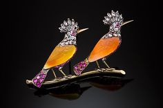 Antique ruby, old cut diamonds, carved carnelian, silver and gold Kingfishers brooch. 19th century.