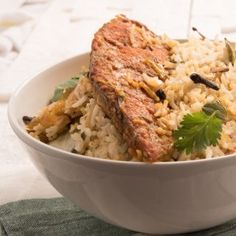Malabar Fish Biryani Recipe - This classic Malabar Fish Biryani can be devoured at all times. Enjoy the delicious taste of this ever-charming dish.