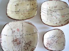 Lari Washburn ceramic plates http://www.flickr.com/photos/lariwashburn/sets/72157624252589881/with/4742930208/