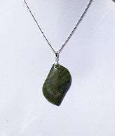 A personal favorite from my Etsy shop https://www.etsy.com/listing/233560619/serpentine-gemstone-pendant-necklace