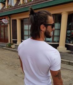 Men with long hair bun