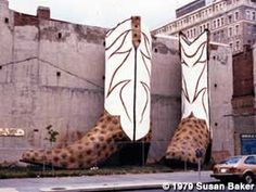 """Cowboy Boots - 40 feet tall and 35 feet wide, tower next to the parking garage at the North Star Mall. Their official name is """"Giant Justins,"""" and they were built in the late 1970s by Bob """"Daddy-O"""" Wade;  photo by Susan Baker in 1979 when the boots were in Washington, D.C.  (moved to Texas in 1980)"""
