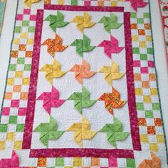 Pinwheel Quilt -I made this with a white background and black and red pinwheels.  Still a really cute baby quilt!