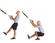 TRX Single Leg Squat Stand Facing  Builds strength evenly and fully activates hips, glutes and quads.  Tips: Do not round back when lowering into squat. Keep tall posture. Perform on both sides.  Adjustment: M  Advanced Strength Exercises | TRX Advanced Suspension Training