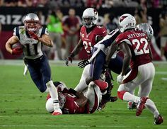 Julian Edelman Photos Photos - Wide receiver Julian Edelman #11 of the New England Patriots is tackled by middle linebacker Kevin Minter #51 of the Arizona Cardinals during the NFL game at University of Phoenix Stadium on September 11, 2016 in Glendale, Arizona. New England won 23-21. - New England Patriots v Arizona Cardinals