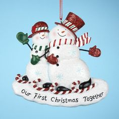 "$104.99-$129.99 Club Pack of 12 ""First Christmas Together"" Snowman Couple Christmas Ornaments - From the Snow Dudes Collection Item #A0494 Celebrate your first Christmas together for years to come with these snowman couple ornaments. Snowman couple wears red glittery hats and candy cane ice skates. Ornaments read: ""Our First Christmas Together"" Ornaments are one-sided, flat-backed  Ornaments com ..."