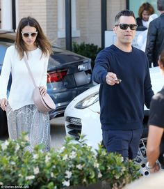 Shop till you drop! Jessica Alba and her husband Cash Warren were spotted leaving Barney's...