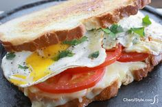 Bite into a fried egg grilled cheese sandwich with Fontina and arugula #grilledcheese