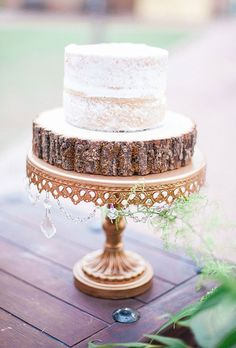 Brides.com: . A one-tier wedding cake displayed on a rustic wooden stand, created by  My Goodness Cakes.