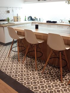 potentially tile floor just for kitchen? i like the large pattern tile