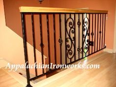 decorative indoor iron guard rail with oak top rail.  By Appalachian Ironworks Salem, Virginia Appalachian Ironworks of Virginia.  Julin@appalachianironworks.com