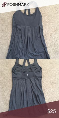Lululemon gray tank top Gray Lululemon tank top. Darling braided details on the straps!  Only wore a few times. Only selling because my closet is too full!   this top is a size 4.  Too adorable to pass up!   lululemon athletica Tops Tank Tops