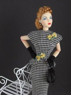 White Orchid Gene Marshall in a 2-piece houndstooth dress with peplum and vintage applique detailing from The Couture Touch. Circa 1940s.