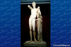 Hermes and the Infant Dionysus, another of the masterpieces on display at the Ancient Olympia Museum The Masterpiece, Dionysus, Olympia, Hermes, Photo Galleries, Infant, Sculptures, Museum, Statue