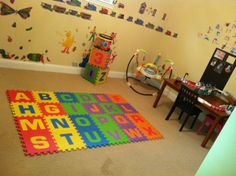 playroom... i miss it like this.. pottery barn table...  buy buy baby play mats target storage. and lots and lots of love and toys..