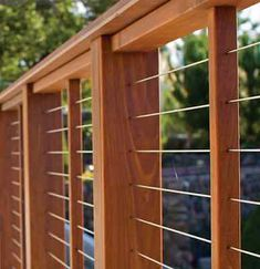 Deck railing isn't just a safety feature. It can add a stunning visual to frame a decked location or deck. These 36 deck railing ideas show you just how it's done! Wire Deck Railing, Deck Railing Design, Deck Design, Porch Railings, Wood Railing Ideas, Outdoor Stair Railing, Deck Stairs, Diy Porch, Diy Deck