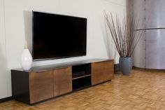 Mid century living room with an extra long custom TV console. Designed by reStyled by Valerie.