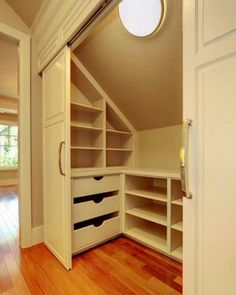 Working with slanted ceilings the shelves could be a great idea for where the closet is now