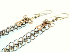 Wire wrapped copper earrings with very long chains. Chain weave made chain armor.  Size earrings: 202 mm in height.