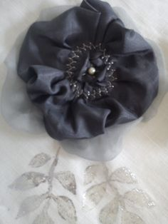 Flower with pearl and silver print.