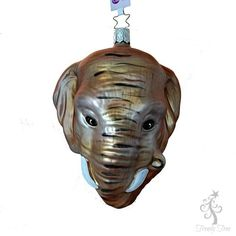 "African Elephant Christmas Ornament 1-101-16 Inge-Glas Size: 5"" ht; 3 3/4"" width; 3"" depth Ornament does not come in a box. Handmade in Germany, mouth blown, hand painted glass."