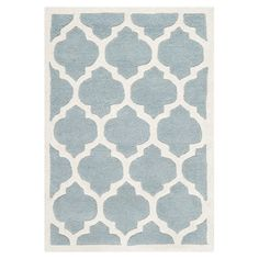 Wool rug with a trellis motif. Hand-tufted in India.    Product: RugConstruction Material: 100% WoolColor:...