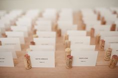 Wine Cork Escort Cards to go with the wine cork table numbers. This would be awesome with make-your-own-wine/beer favors!