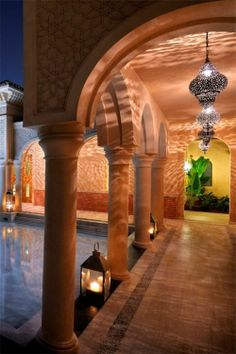 Moroccan lighting in a Riad's courtyard. #Moroccan #Patterns #Lighting #Riad.