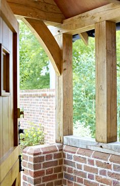 Peering out of the rear stable door covered by a golden coloured oak framed porch. Building A House, Front Porch Design, Timber Frame Porch, Cottage Door, Timber Framing, House Front, Oak Frame House, Front Door Porch, Oak Framed Buildings