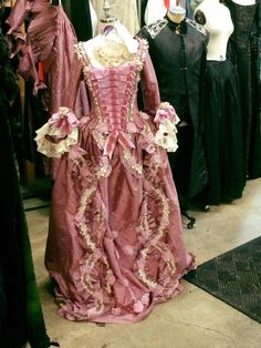 Period Corsets made the under corset for this amazing ensemble. Salem costumers added the trim. (Our leather bodice and pink corset are also in the background here)