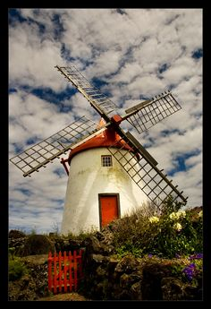 Windmill in Portugal Holland Windmills, Old Windmills, Azores, Moulin France, Tilting At Windmills, Amsterdam, Blowin' In The Wind, Portugal, Thinking Day