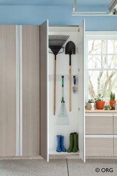 Garden & tool storage behind doors to keep the garage organized. HomeORG.com