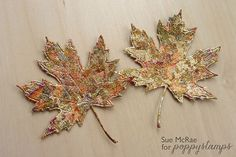 card making embellishments by Sue McRae: Gilded Leaves ... put double side adhesive on cardstock ... then run through die cutting machine ... remove the protective layer and press on gilding ...