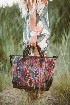 """Embrace the Spirit of Guatemala with this Beautiful Handbag. More Photos Coming Soon Genuine Suede or Leather // Rich Textured Patterns // Handcrafted in Guatemala Size: 15' H x 21 ' W x 7.5 """" Deep Ea"""