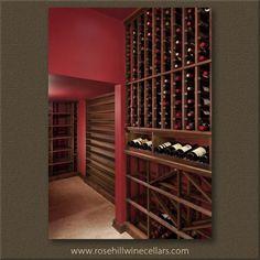Custom walnut #wine racks with warm burgundy walls, the perfect combination! More great #winestorage at Rosehill Wine Cellars!