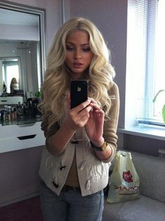Voluminous curls....I would kill to have my hair look like this. But I'd probably close my mouth for the picture.