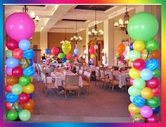 Not these colours but bright bold colours, balloon centrepieces on each table. Make it fun, carnival themed. Get everybody in the mood to spend money, drink, have a good time.