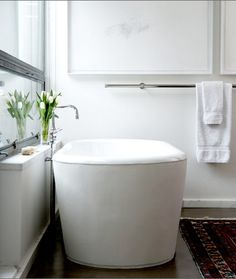 trend: tall tub - http://houseandhome.com/blogs/house-home-daily/suzannes-top-bathrooms