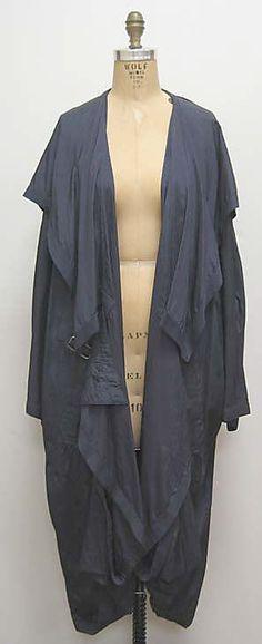 """Pocketable Raincoat"" Miyake Design Studio  (Japanese)  Designer: Issey Miyake (Japanese, born 1938) Date: 1984 Culture: Japanese Medium: synthetic, cotton, resin, metal"