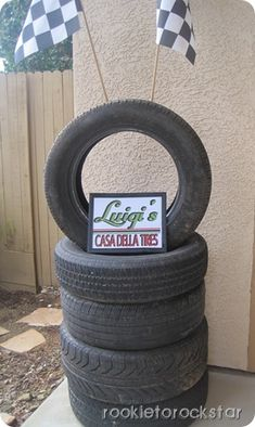 """CARS party- The stacked tires w/ sign """"Luigi's Casa Della Tires"""" is ingenious!!"""
