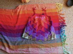 Judah's perfect first birthday dress and ringsling.  Earthy rainbow girasol and The Gap. it was too perfect to pass up!