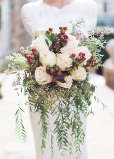 Wedding Flowers These pale pink roses and a red pop make this winter bouquet complete. - Flaunting flowers that are readily available in the season of your wedding will help you save big on a beautiful bouquet! Winter Wedding Flowers, Floral Wedding, Christmas Wedding Bouquets, Holiday Wedding Ideas, Christmas Wedding Decorations, Blue Wedding, Church Wedding, Winter Flowers In Season, Elegant Wedding